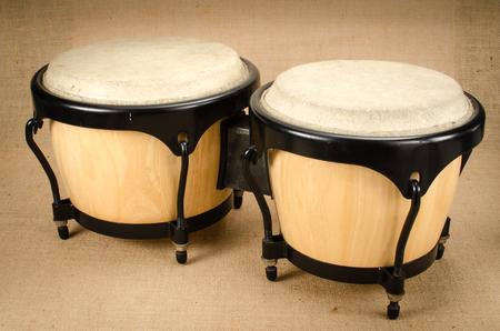bongo: Latin Wooden Bongo on brown sack background