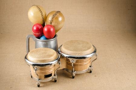 bongo: Image of maracas with bongo on brown sack background Stock Photo