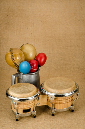 bongo drum: Image of maracas with bongo on brown sack background Stock Photo
