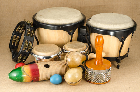 Image of latin percussion set on brown sack background Imagens - 34918753