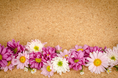 flowers bouquet: Image of flowers on brown cork  background