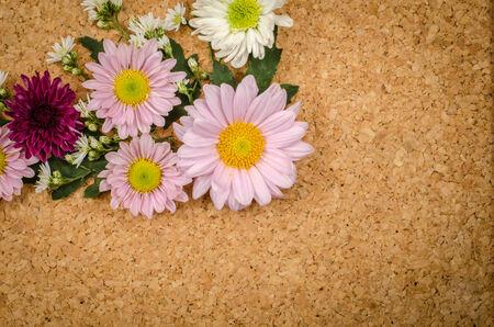 brown cork: Image of flowers on brown cork background