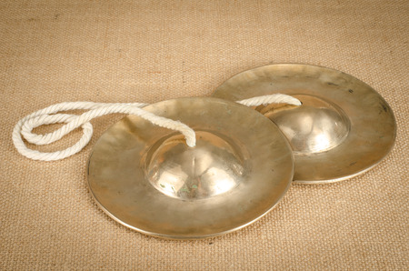 cymbal: Thais cymbal on brown sack background