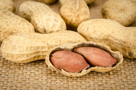 close up image: Close up image of Roasted peanuts on brown sack background Stock Photo