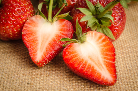 close up image: Close up Image of strawberries on brown sack background