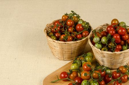 brownish: Cherry tomatoes on brownish sack background Stock Photo