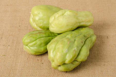 chayote: Fresh green Chayote on brown sack background