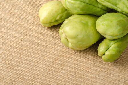 chayote: Fresh green Chayote on brown sack background