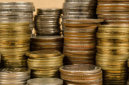coins: Stack of coins on brown sack background Stock Photo