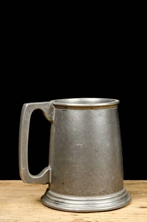 pewter mug: Old aluminium beer mug on black background Stock Photo