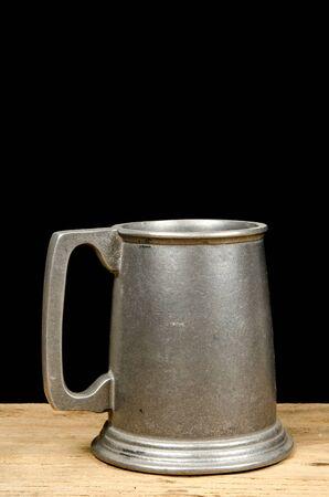 pewter mug: Old aluminium beer mug on black background Stock Photo