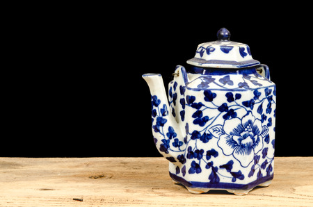 chinese tea pot: Image of ancient Chinese tea pot on black background Stock Photo