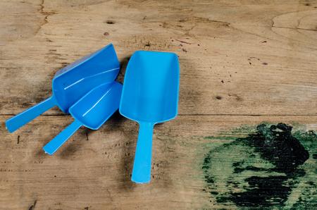 baby cutlery: Blue plastic spoon on old wood desk