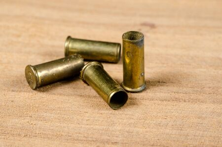 casings: Bullet casings on wooden desk