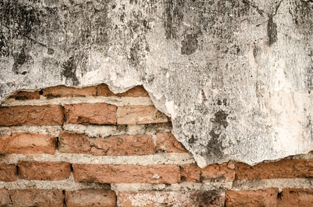 cracked wall: Old Red Brick Wall With Damaged Grey Plaster Abstract Background