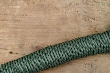 nylon string: Coiled green nylon rope on old wood