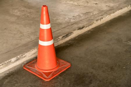 traffic cone: Orange Plastic Traffic cone on the road Stock Photo