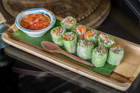spring roll: Fresh Vietnam spring roll in wooden plate