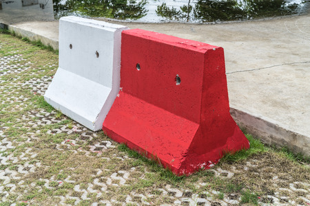 barrier: Red and white concrete barrier Stock Photo