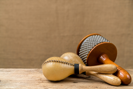 bongos: Cabasa, Maracas, Latin percussion on wooden desk and brown sack background