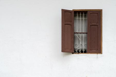 locality: Thais locality windows on white concrete wall Stock Photo