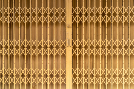 Old style Yellow metal shutter gate