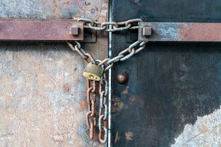 rusty chain: Rusty iron shutter gate with chain locked