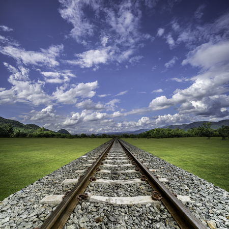 thru: Perspective of railway thru green lawn with blue sky background concept idea for the way to success