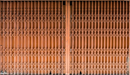 Old style brown metal shutter gate