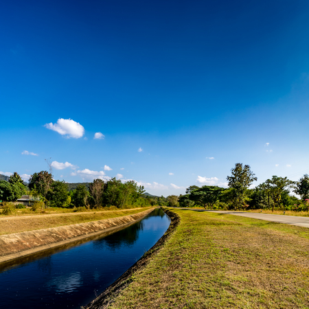 waterway: waterway canal for agriculture with blue sky