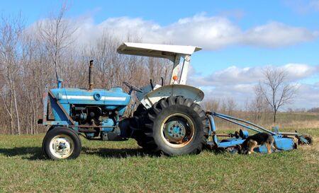 white trim: Blue tractor with white trim in field