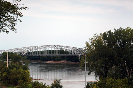 Metal bridge over the Missouri River in Jefferson City, Missouri, as seen from the State Capitol grounds