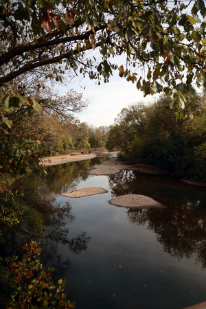 Landscape of a river lined with trees in Mark Twain National Forest, Southwest Missouri, USA, in October Stock fotó