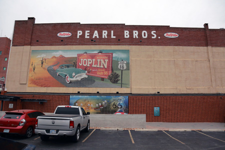 Famous Route 66 mural at the Route 66 Mural Park in historic downtown Joplin, Missouri, in November 2017. Mural is on the side of the Pearl Bros. True Value Building.