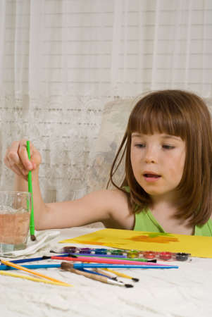 Young girl painting photo