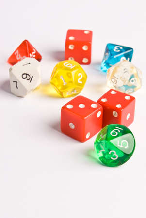 role play: Multicolored role play dice isolated on white. Focus near the front die and a shallow depth of field used to fade the dice out further into the photo. Stock Photo