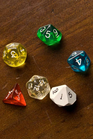 role play: Generic Role Play Dice on Wooden Tabletop