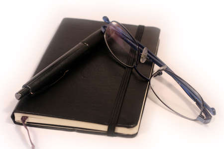 Pen, Diary and Glasses photo