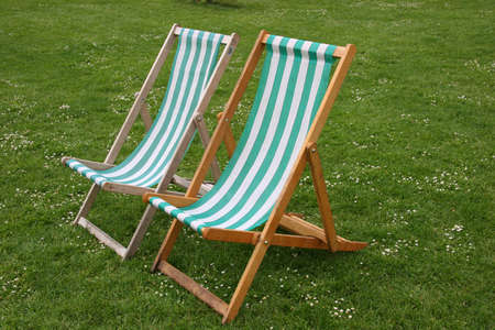 Deck chairs in park  Stock Photo