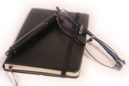 dayplanner: Pen, Diary and Glasses - shallow focus Stock Photo