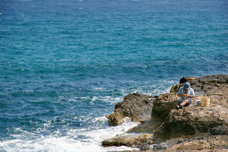 fishman: Fishman on the rocks, crete