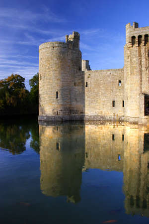 Reflections of Bodiam Castle in front of blue skys Editorial