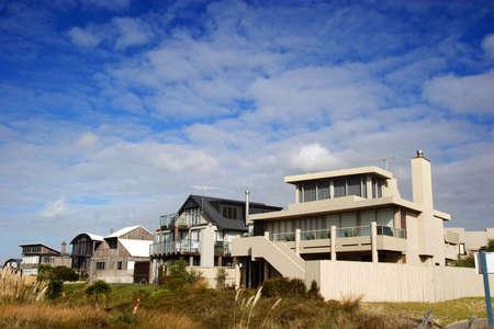 modern beach homes on a sunny day photo