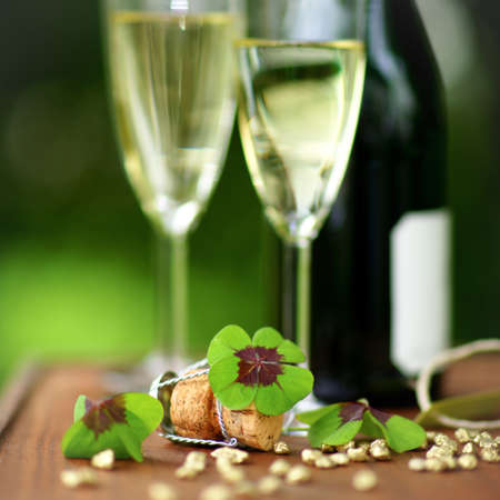 Lucky clover and sparkling wine photo