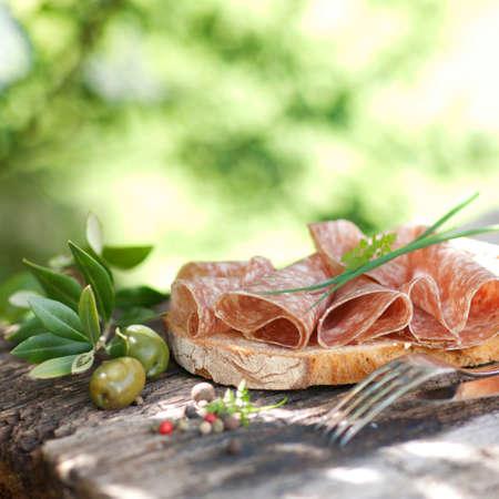 素朴なパンとサラミ 写真素材