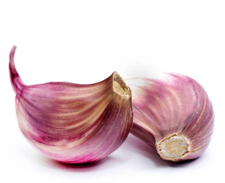 garlic clove: Garlic cloves on white ground Stock Photo