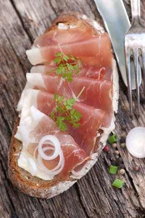 cured ham: Rustic bread with cured ham Stock Photo