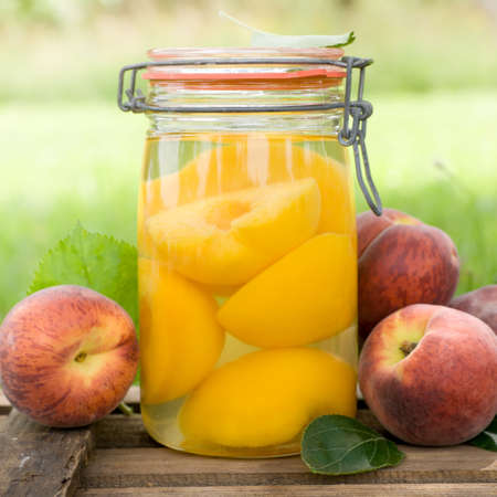 preserving: Peaches in a preserving glass Stock Photo