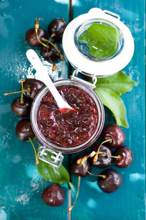 sour cherry: Cherry jam in a preserving glass