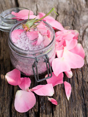 perfumed candle: Bath salt with roses Stock Photo